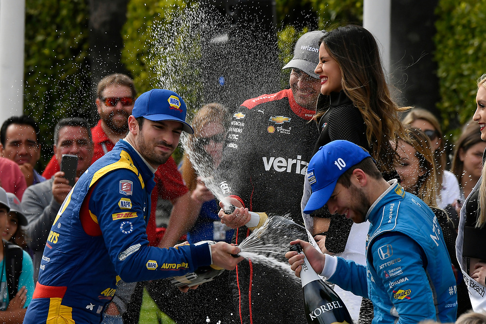 Alexander Rossi, Andretti Autosport Honda, Ed Jones, Chip Ganassi Racing Honda, Will Power, Team Penske Chevrolet celebrates with champagne in victory lane on the podium<br /> Sunday 15 April 2018<br /> Toyota Grand Prix of Long Beach<br /> Verizon IndyCar Series<br /> Streets of Long Beach, California USA<br /> World Copyright: Scott R LePage<br /> LAT Images