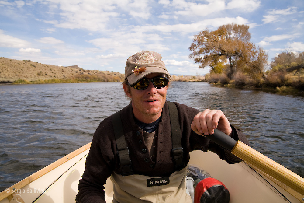 Andy Toohey, CEO of Boulder Boat Works rows one of his driftboats on the North Platte River in Wyoming.