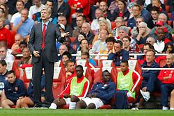 Arsenal's Manager Arsene Wenger reacts  - Photo mandatory by-line: Mitch Gunn/JMP - Tel: Mobile: 07966 386802 17/08/2013 - SPORT - FOOTBALL - Emirates Stadium - London -  Arsenal V Aston Villa - Barclays Premier League