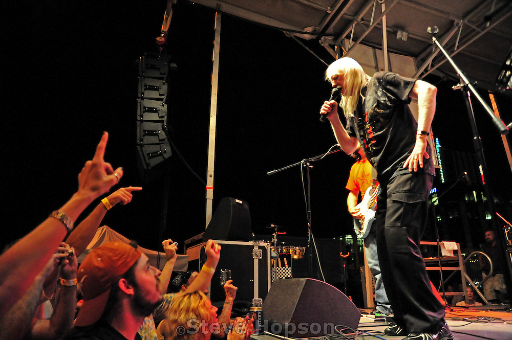 """Edgar Winter performing at Bat Fest in Austin Texas, August 30 2008. Edgar Winter (b. 1946) is a keyboard player, vocalist, saxophonist and percussionist; albino; and brother of bluesman Johnny Winter. The Edgar Winter Group recorded the #1 hit instrumental """"Frankenstein"""" in 1972 and pioneered the use of the synthesizer as a lead instrument. The band also recorded the hit songs, """"Free Ride"""" and """"Easy Street"""".  Bat Fest is a street festival held in honor of Austin's colony of Mexican Free-Tailed bats, which is the world's largest urban bat colony."""
