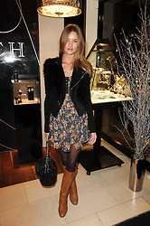 ROSIE HUNTINGTON-WHITELEY at a party for TACH jewellery held at Tach, 13 Grafton Street, London on 10th December 2009.