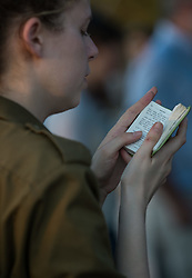 An Israeli young woman reads Torah at a joint funeral for the three Israeli teens at a cemetery in Modi'in near Jerusalem, on July 1, 2014. The three Israeli teens whose bodies were found Monday evening were brought to rest side by side on Tuesday at a joint funeral held in Modi'in near Jerusalem. Tens of thousands of people participated in the funeral, including Prime Minister Benjamin Netanyahu and President Shimon Peres, who eulogized the three, whose caskets were wrapped with Israeli flags. EXPA Pictures © 2014, PhotoCredit: EXPA/ Photoshot/ Li Rui<br /> <br /> *****ATTENTION - for AUT, SLO, CRO, SRB, BIH, MAZ only*****