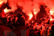 Rennes fans set alight red flares at kick off during the Europa League round of 16, leg 2 of 2 match between Arsenal and Rennes at the Emirates Stadium, London, England on 14 March 2019.
