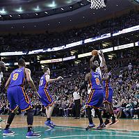 04 March 2012: Boston Celtics shooting guard Ray Allen (20) takes a jumpshot over New York Knicks guard Iman Shumpert (21) during the Boston Celtics 115-111 (OT) victory over the New York Knicks at the TD Garden, Boston, Massachusetts, USA.