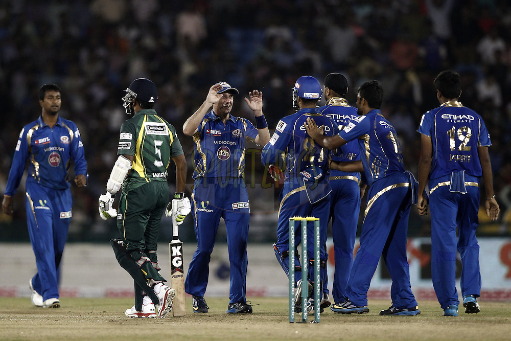 Mumbai Indians Players celebrates the wicket of Seekkuge Prasanna of the SOUTHERN EXPRESS  during the qualifier 4 match of the Oppo Champions League Twenty20 between the Mumbai Indians and the Southern Express held at the Chhattisgarh International Cricket Stadium, Raipur, India on the 14th September 2014<br /> <br /> Photo by:  Deepak Malik / Sportzpics/ CLT20<br /> <br /> <br /> Image use is subject to the terms and conditions as laid out by the BCCI/ CLT20.  The terms and conditions can be downloaded here:<br /> <br /> http://sportzpics.photoshelter.com/gallery/CLT20-Image-Terms-and-Conditions-2014/G0000IfNJn535VPU/C0000QhhKadWcjYs