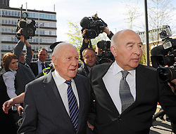 (Right) Stuart Hall, accompanied by Maurice Watkins, leaves Preston Crown Court after pleading guilty to 14 charges of indecent assault, UK, May 2, 2013. Photo by:  i-Images
