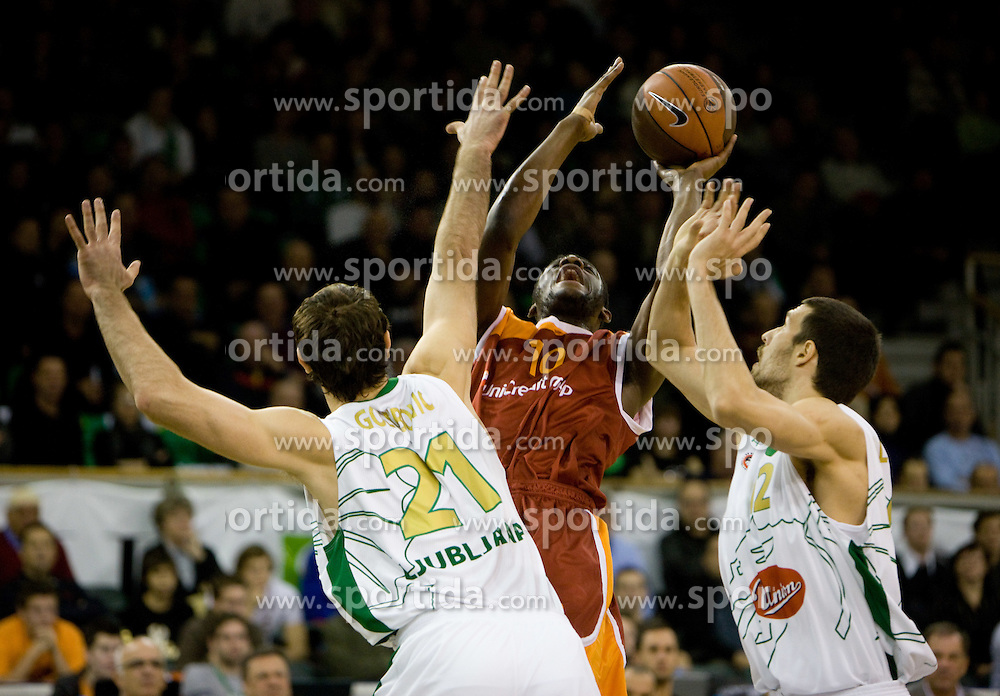 Herve Toure   of Lottomatica between Vladimir Golubovic (21) of Olimpija and Nemanja Aleksandrov (12) of Olimpija at Euroleague basketball match in 5th Round of Group C between KK Union Olimpija and Virtus Lottomatica Roma, on November 25, 2009, in Arena Tivoli, Ljubljana, Slovenia. (Photo by Vid Ponikvar / Sportida)