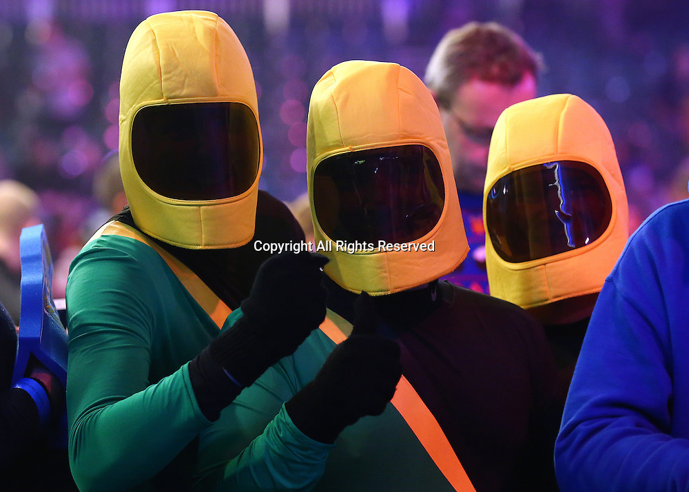 23.12.2016. Alexandra Palace, London, England. William Hill PDC World Darts Championship. Fans in Space suits take their spot in the front row