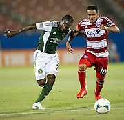 FRISCO, TX - JUNE 26:  Diego Chara #21 of the Portland Timbers and David Ferreira #10 of FC Dallas battle for the ball on June 26, 2013 at FC Dallas Stadium in Frisco, Texas.  (Photo by Cooper Neill/Getty Images) *** Local Caption *** Diego Chara; David Ferreira