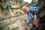 SPAIN, NORTH COAST, GALICIA SANTIAGO DE COMPOSTELA; a pilgrim who has hiked the Route of St. James (Santiago) at the Cathedral entrance