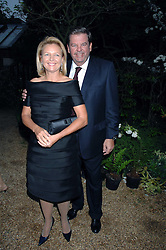 MR & MRS JOHANN RUPERT he is Chief Executive of Richemont  at the annual Cartier Chelsea Flower Show dinner held at the Chelsea Physic Garden, London on 21st May 2007.<br /><br />NON EXCLUSIVE - WORLD RIGHTS