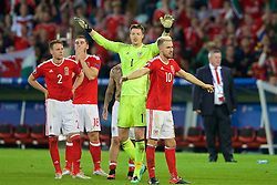 LILLE, FRANCE - Friday, July 1, 2016: Wales Chris Gunter, Sam Vokes, Wales goalkeeper Wayne Hennessey and Aaron Ramsey celebrate the 3-1 victory against Belgium at full time after the UEFA Euro 2016 Championship Quarter-Final match at the Stade Pierre Mauroy. (Pic by Paul Greenwood/Propaganda)