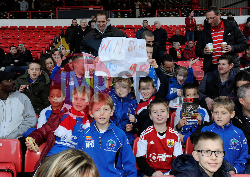 Young Bristol City fans with a home made sign - Photo mandatory by-line: Dougie Allward/JMP - Tel: Mobile: 07966 386802 01/03/2014 - SPORT - FOOTBALL - Bristol - Ashton Gate - Bristol City v Gillingham - Sky Bet League One