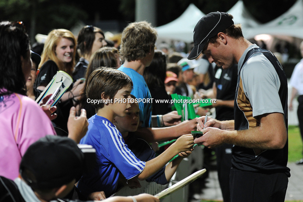 Martin Guptill signs autographs after winning the 2nd International Twenty-20 cricket match, New Zealand vs Zimbabwe, Seddon Park, Hamilton, New Zealand, 14 February 2012. Photo: Owen Harrison/photosport.co.nz