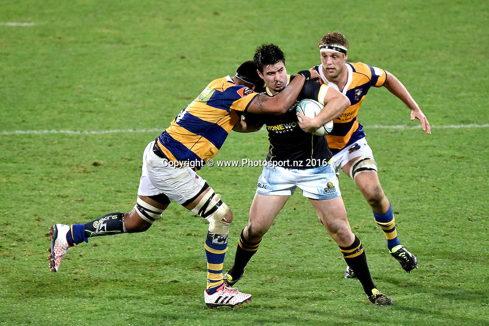 Lion's Jackson Garden-Bachop (C is tackled by Bay of Plenty's Shahn Eru during the Mitre 10 Cup - Wellington vs Bay of Plenty rugby match at Westpac Stadium on Friday the 16th of September 2016. Copyright Photo by Marty Melville / www.Photosport.nz