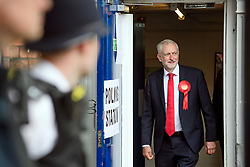 © Licensed to London News Pictures. 08/06/2017. London, UK. Police officers watch over as  Leader of the Labour Party Jeremy Corbyn votes at a school in his constituency of Islington North in London. Earlier this year British prime minister Theresa may Prime Minister Theresa May received the necessary two-thirds majority vote in parliament to call a snap election. Photo credit: Ben Cawthra/LNP