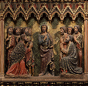The resurrected Christ joins his disciples in Galilee, holding the book of life - some worship him but others doubt, He asks them to go and preach, on the South choir screen, 1351, by Jean le Bouteiller, carved polychrome wood with 9 scenes of the apparitions of Christ after his resurrection, separated by columns, in the Cathedrale Notre-Dame de Paris, or Notre-Dame cathedral, built 1163-1345 in French Gothic style, on the Ile de la Cite in the 4th arrondissement of Paris, France. The choir screen was restored in the 19th century under Viollet le Duc. Photographed on 17th December 2018 by Manuel Cohen