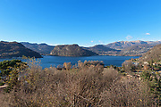panoramic view of Lugano Lake, blue sky