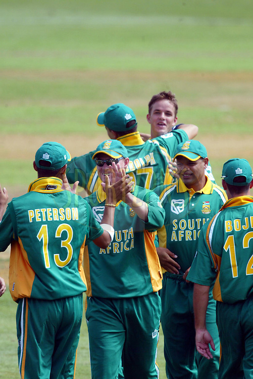 11th February 2004. Cricket, South African tour of New Zealand, Westpac Park, Hamilton, New Zealand..South Africa vs Northern Knights..Lance Klusener & Robin Peterson of South Africa celebrate with team..South Africa won by 6 wickets..Please credit: Sandra Teddy/ Photosport