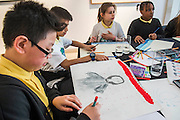 Pupils from Charlton Manor Primary School - one of 10 sustainable legacy projects to receive funding from Captain Planet Foundation as part of It's Our World - It's Our World Auction in support of The Big Draw and Jupiter Artland Foundation, Chrisites, London, UK - Over 40 leading artists including David Hockney, Sir Antony Gormley, David Nash, Sir Peter Blake, Yinka Shonibare, Sir Quentin Blake, Emily Young and Maggi Hambling have committed artworks to the be sold at on 10 March 2016. The Auction is the culmination of a mass participation environmental arts project, promoting sustainability for future generations through art. Money raised will support The Big Draw, an arts education charity that works across the UK to promote visual