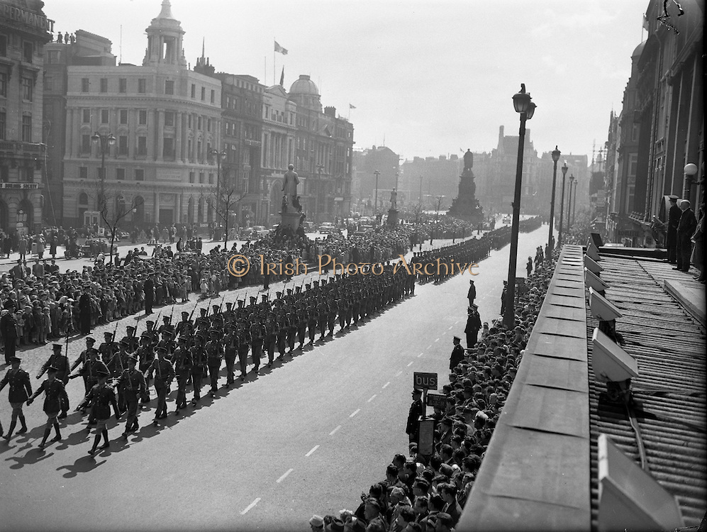 Easter Sunday Military Parade. A seemingly endless line of marching men stretches along O'Connell Street..22.04.1962