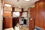 inside of a dilapidated caravan