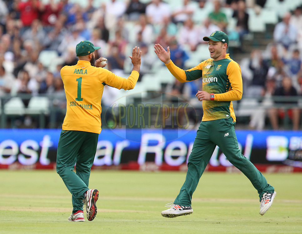 Hashim Alma congratulates David Miller  during the First KFC T20 Match between South Africa and England played at Newlands Stadium, Cape Town, South Africa on February 19th 2016