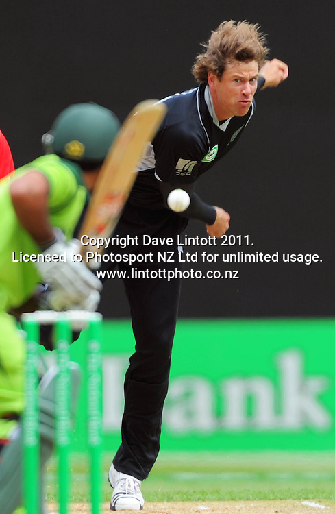 NZ's Jacob Oram bowls to Kamzan Akmal. First one-day international cricket match - New Zealand v Pakistan at Westpac Stadium, Wellington, New Zealand on Saturday, 22 January 2011. Photo: Dave Lintott / photosport.co.nz
