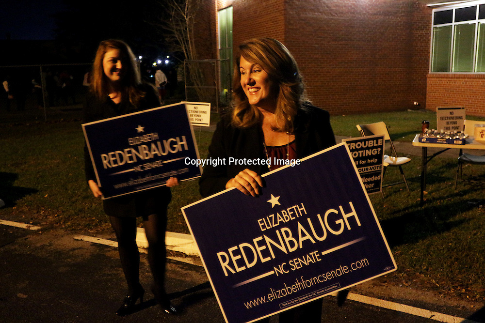 Elizabeth Redenbaugh, candidate for NC Senate District 9, right, and her campaign manager Erin Rogers hold signs outside of Mosley Performance Learning Center Tuesday November 4, 2014 in Wilmington, N.C. (Jason A. Frizzelle)