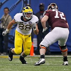 January 3, 2012; New Orleans, LA, USA; Michigan Wolverines defensive end Craig Roh (88) rushes against Virginia Tech Hokies offensive tackle Andrew Lanier (72) during the Sugar Bowl at the Mercedes-Benz Superdome. Michigan defeated Virginia 23-20 in overtime. Mandatory Credit: Derick E. Hingle-US PRESSWIRE