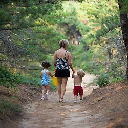 A woman and her young children walk to the beach at the Cape Cod National Seashore in Truro, Massachusetts.  Path from North of Highland Campground.