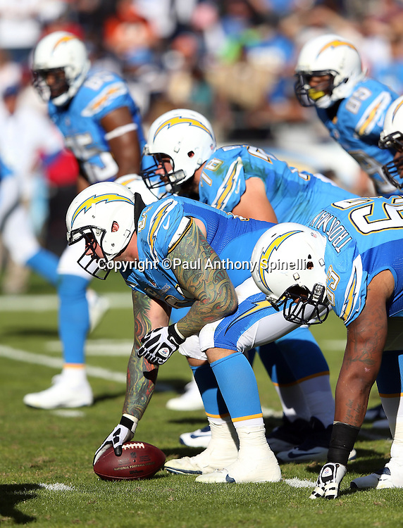 San Diego Chargers center Nick Hardwick (61) gets set to snap the ball while lined up with the offensive line at the line of scrimmage during the NFL week 13 football game against the Cincinnati Bengals on Sunday, Dec. 1, 2013 in San Diego. The Bengals won the game 17-10. ©Paul Anthony Spinelli