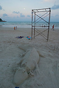 The notorious Full Moon Party at Hat Rin beach on the small Thai island of Ko Pha-Ngan is Asia's biggest regular rave event..A sand croc waits for the music to start.