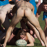 Rachel Scott, 21, releases the ball in the tackle during the 'Nude Blacks' versus a Fijian invitation side played at Logan Park, Dunedin as an unofficial curtain raiser match before the New Zealand V Fiji test match in Dunedin, New Zealand...The 'Nude Blacks' won the match 20-10 with 21 year old female player Rachel Scott, a member of the Otago women's rugby team named player of the day. .Over 500 people turned up to watch the match which included a blind referee, Julie Woods and three clothed streakers who were ejected from the playing area..The 'Nude Blacks' traditionally play games before test matches in Dunedin and were using this match as a warm up for three nude games planned during the IRB Rugby World Cup in New Zealand with teams from Argentina, Italy, England and Ireland involved.  Matches will be played before World Cup games in Dunedin. New Zealand. 22nd July 2011. Photo Tim Clayton