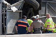 Crews from Jordan and J&J towing companies work with DPS officers to upright an overturned Cardinal Coach Line charter bus on Hwy. 161 near N. Belt Line Rd.  in Irving on Thursday, April 11, 2013. The accident resulted in two deaths and 41 hospitalized. (Cooper Neill/The Dallas Morning News)