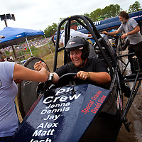NAPLES, FL -- March 6, 2011 -- Pressures On driver Andy Sims is congratulated after winning his V8 Sportsman heat during the Swamp Buggy Races at the Florida Sports Park in Naples, Fla., on Sunday, March 6, 2011.  The races originated in the 1940's by bored hunters and draws thousands of fans three times a year to take in the buggies and jeep compete in the swamp. (Chip Litherland for ESPN the Magazine)