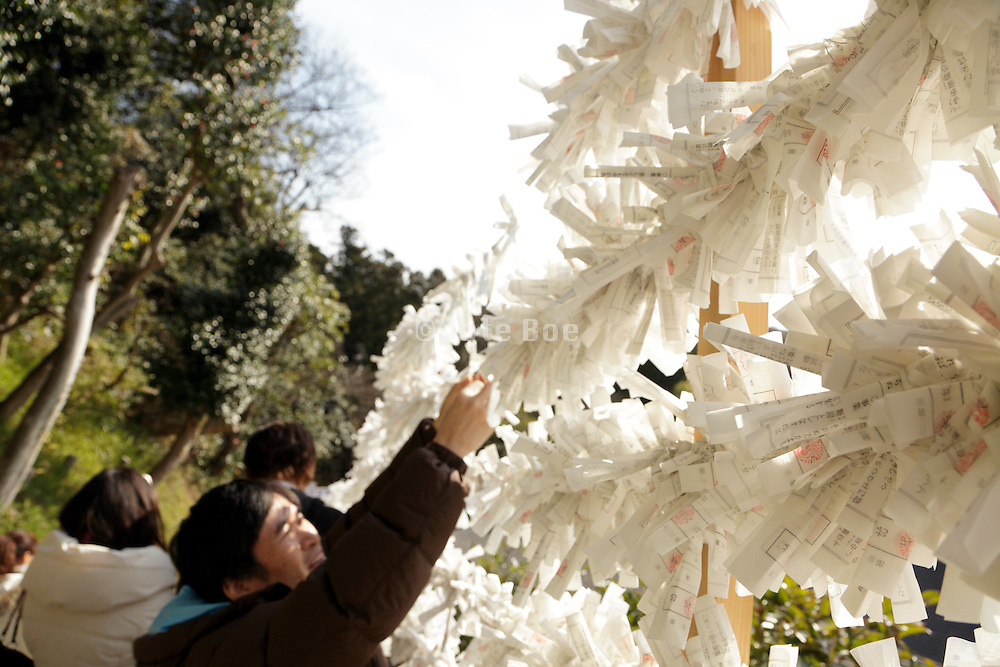 Omikuji prayers tied to string outside an Asian temple