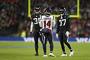 Houston Texans Wide Receiver DeAndre Carter (14) Jacksonville Jaguars Defensive Back Breon Borders (31) Jacksonville Jaguars Defensive Back Tre Herndon (37) during the International Series match between Jacksonville Jaguars and Houston Texans at Wembley Stadium, London, England on 3 November 2019.