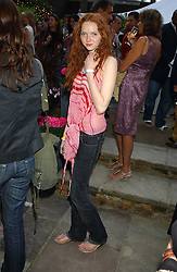 Model LILY COLE at Michele Watches Kaleidoscope Summer Garden Party held at Home House, Portman Square, London on 15th June 2005.<br /><br />NON EXCLUSIVE - WORLD RIGHTS