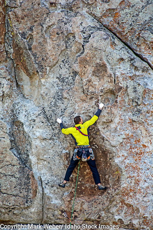 Elijah Weber rock climbing a route called Rollercoaster which is rated 5,9 and located on Bath Rock at the City Of Rocks National Reserve near the town of Almo in southern Idaho