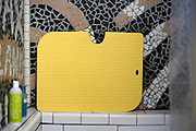 yellow mat in shower room