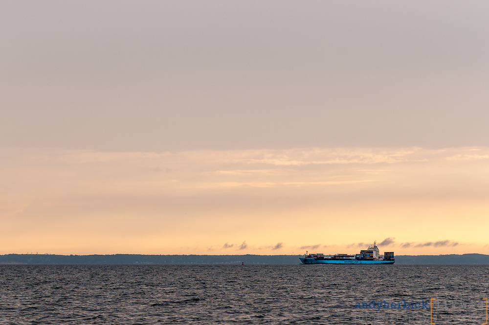 JUNE 13, 2014 - Chesapeake Bay, MD, USA - A blue Maersk LIne container ship heads south down Chesapeake Bay at sunset - taken from onboard S/V Raekved during a delivery from the Florida Keys to Annapolis, MD. - IMAGE © 2014 Andy Herbick | www.andyherbickphotography.com - ALL RIGHTS RESERVED.