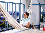 AMSTERDAM- A girl is relaxing in her hammock in her home. COPYRIGHT ROBIN UTRECHT