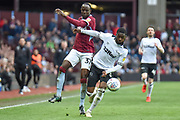 Aston Villa midfielder Albert Adomah (37) battles for possession with Derby County defender (on loan from Chelsea) Fikayo Tomori (5) during the EFL Sky Bet Championship match between Aston Villa and Derby County at Villa Park, Birmingham, England on 2 March 2019.