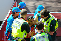A runner receives medical attention at the finish<br /> The Virgin Money London Marathon 2014<br /> 13 April 2014<br /> Photo: Javier Garcia/Virgin Money London Marathon<br /> media@london-marathon.co.uk