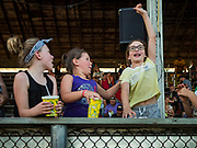 "26 JUNE 2019 - CENTRAL CITY, IOWA: Girls cheer during the ""Mutton Bustin' "" contest at the Linn County Fair. Mutton Bustin' is an event for young children. They ride sheep bareback for six seconds. Summer is county fair season in Iowa. Most of Iowa's 99 counties host their county fairs before the Iowa State Fair, August 8-18 this year. The Linn County Fair runs June 26 - 30. The first county fair in Linn County was in 1855. The fair provides opportunities for 4-H members, FFA members and the youth of Linn County to showcase their accomplishments and talents and provide activities, entertainment and learning opportunities to the diverse citizens of Linn County and guests.      PHOTO BY JACK KURTZ"