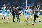 Manchester City Manager Pep Guardiola and Manchester City players celebrate after the Premier League match between Crystal Palace and Manchester City at Selhurst Park, London, England on 14 April 2019.