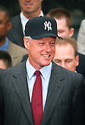 President Bill Clinton wears a New York Yankees baseball cap as the 1998 World Series winning Yankees visited the White House June 10, 1999 in Washington, DC.