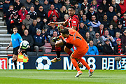 Joshua King (17) of AFC Bournemouth is challenged by Hugo Lloris (1) of Tottenham Hotspur during the Premier League match between Bournemouth and Tottenham Hotspur at the Vitality Stadium, Bournemouth, England on 4 May 2019.
