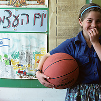 Israel, Jerusalem, Moshav Qeshet, Portrait of young schoolgirl holding basketball at school in Golan Heights